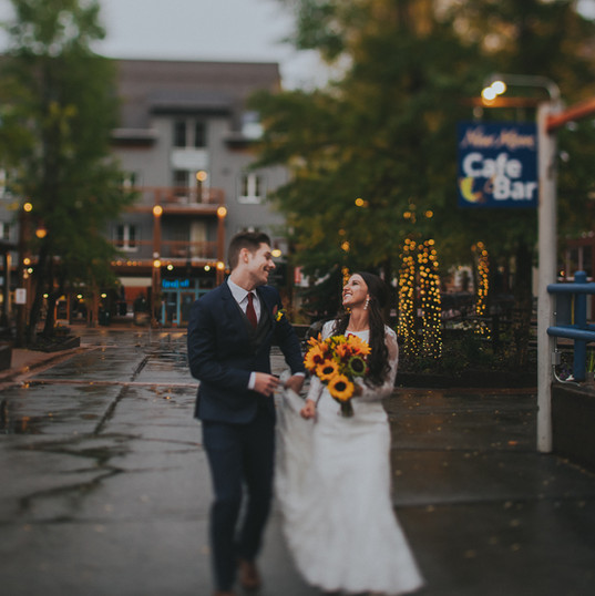 A groom and bride smile at each other during a Warren Station at Keystone fall wedding
