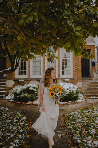 A portrait of a bride underneath a tree during a fall wedding in Milwaukee
