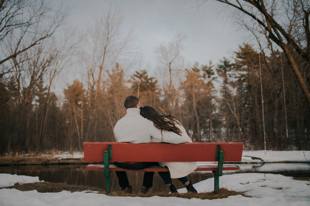 A man and woman sit on a bench in Stevens Point