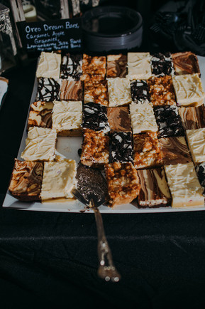 A large tray of cheesecake assortments