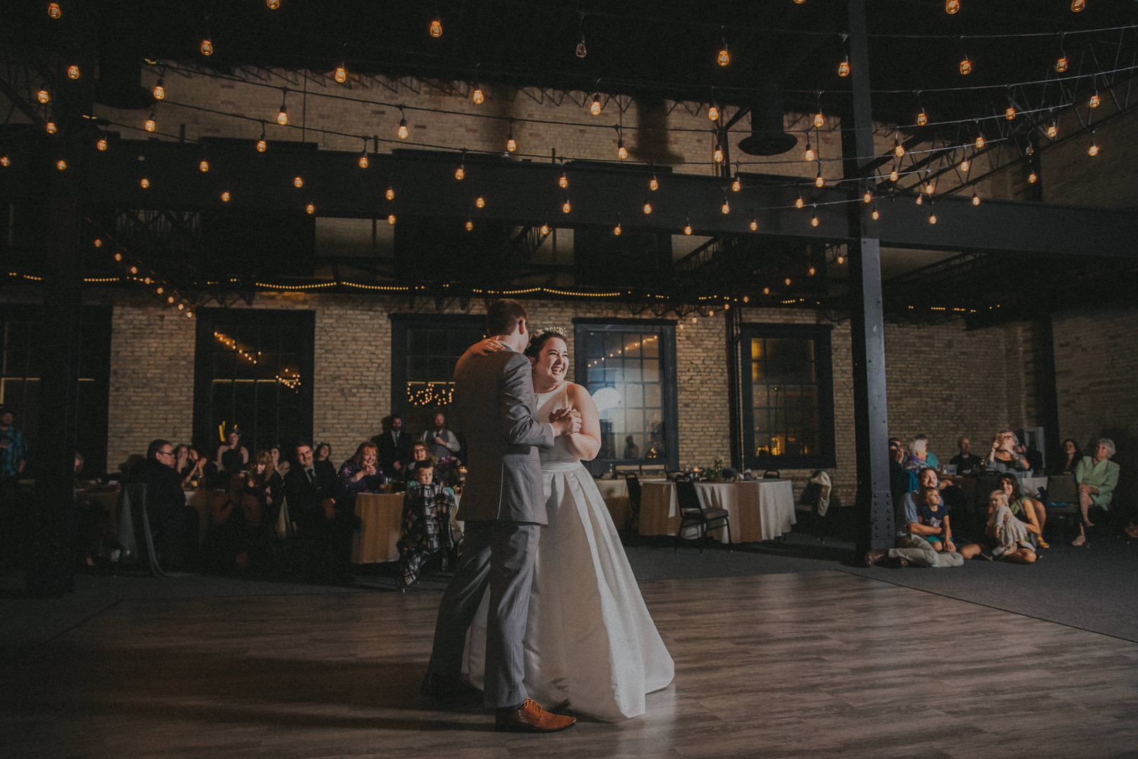 A groom and bride share their first dance together at The Berkshire Sheboygan