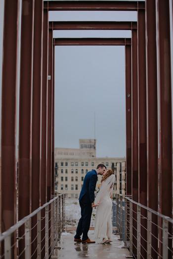 A bride and groom kiss during a Kadish Park wedding