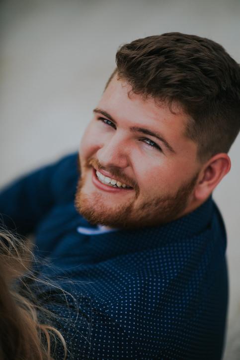 A man smiles at the camera