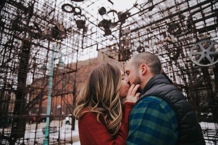 A close up of a woman kissing a man at Catalano Square