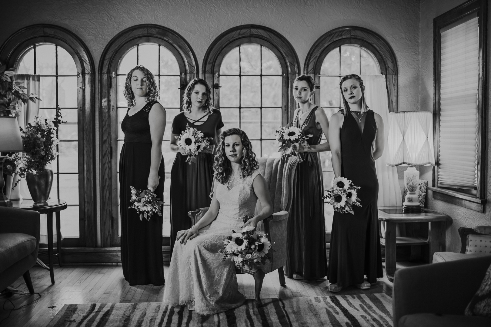 A bridal party poses in front of arches windows at a Downtown Milwaukee Wisconsin Wedding