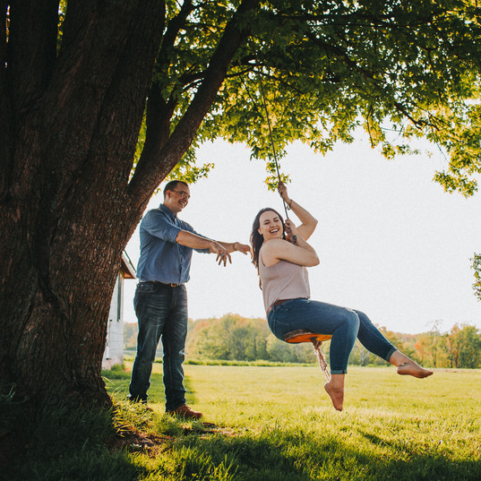 A man pushes a woman on a swing in Oshkosh, Wisconsin