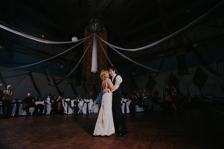 A bride and groom dance during their beckets Oshkosh wedding photos