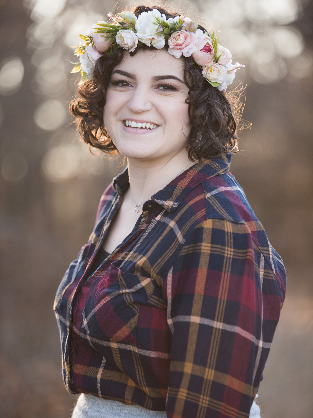 A woman poses while wearing a flower crown
