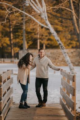 A man and woman walk across a bridge in Stevens Point