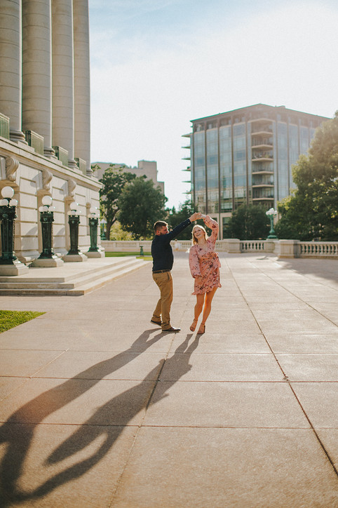 A man and woman dance in front of the Madison Capitol