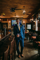 A groom holds a glass of beer in a Red Lion Pub Milwaukee wedding