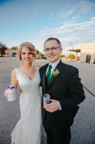A bride and man pose for a photo during Beckets Oshkosh wedding photos