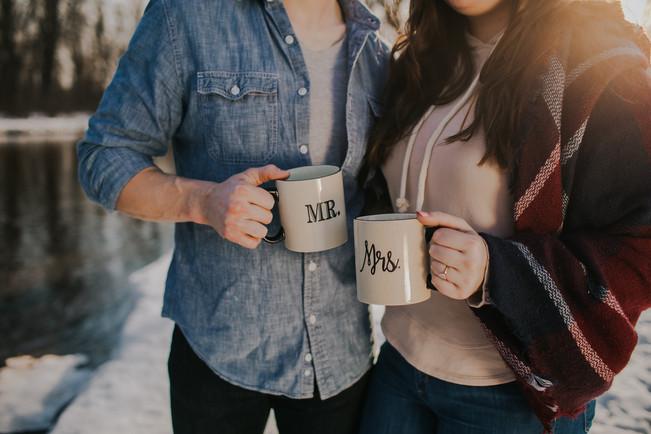 A closeup of couples clinking mugs