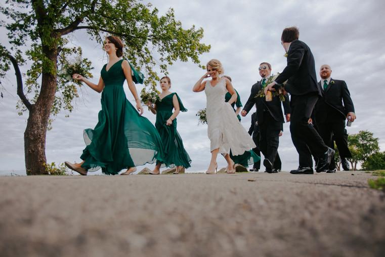 A wedding party walks during a summer wedding in Oshkosh