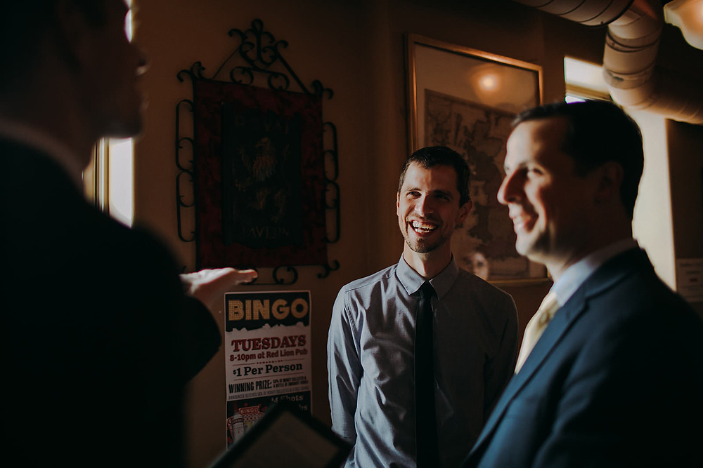 A group of men laugh together - Milwaukee Wedding Photographer