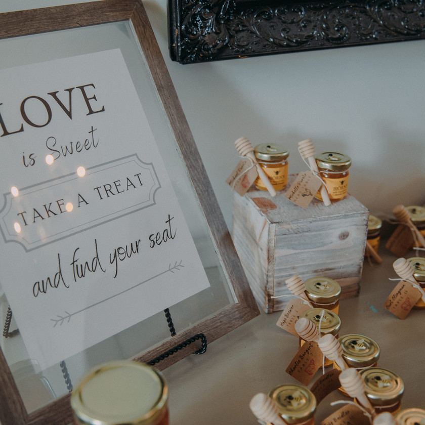 A table full of tiny jars of Bjorn's Colorado Honey for guest favors as a wedding
