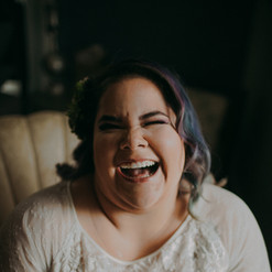 A bride laughs at the camera at Emily's Ten Oak Ranch