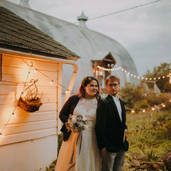 A portrait of a bride and groom at dusk at a Emily's Ten Oaks Ranch wedding