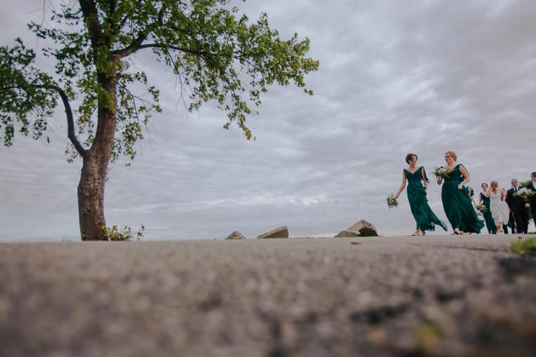 A wedding party walks at Asylum Point
