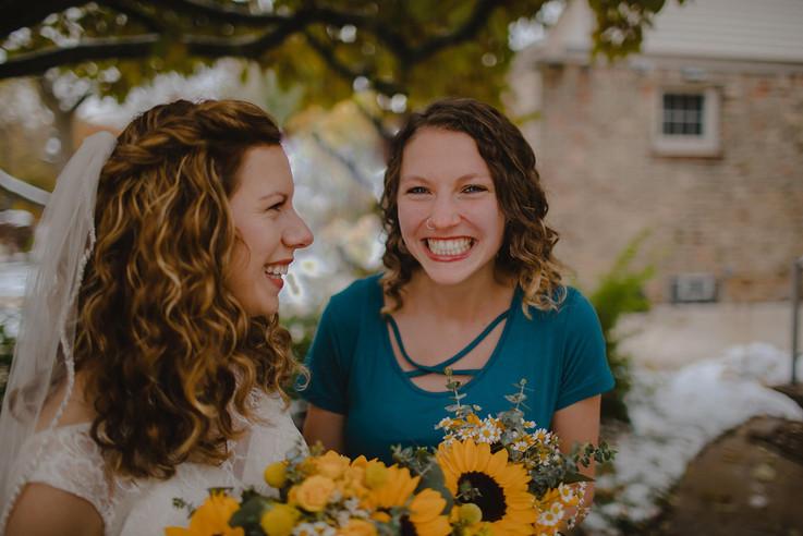 A bridesmaid smiles at the camera