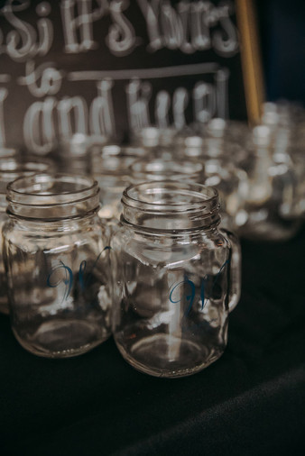 A close up of etched mason jars in a wedding in Milwaukee, Wisconsin