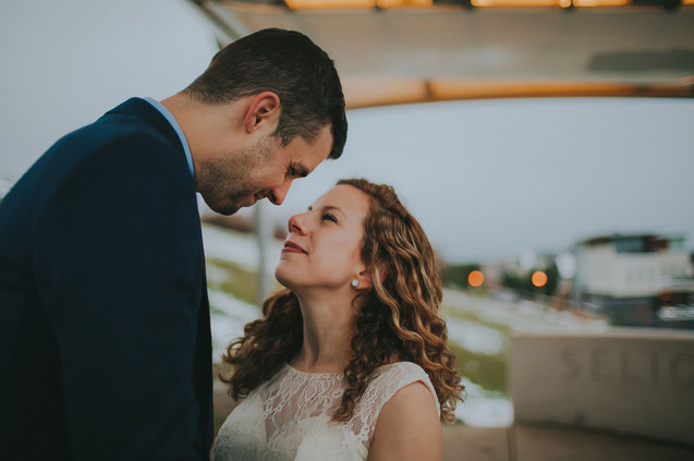 A close up of a bride and groom as they gaze at each other in the Kadish Park amphitheater