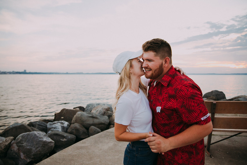 A man and woman laugh together during a Tenney Park engagement session