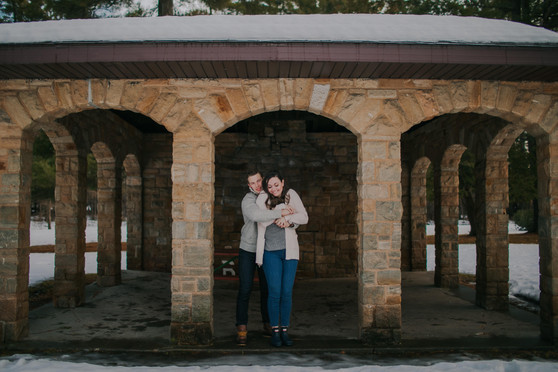 A man and woman hug in historic Iverson Park
