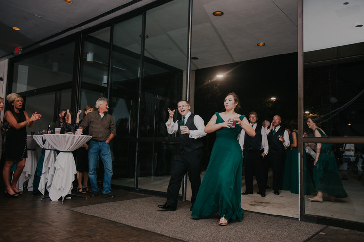 A bridal party enters the Waterfront Atrium during at beckets Oshkosh wedding venue