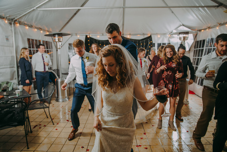 A bride and guests dance during a Red Lion Pub wedding reception