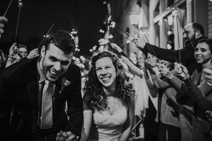 A bride and groom run through a row of sparklers outside the Red Lion Pub Milwaukee