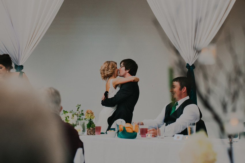 A bride and groom kiss during their Beckets reception