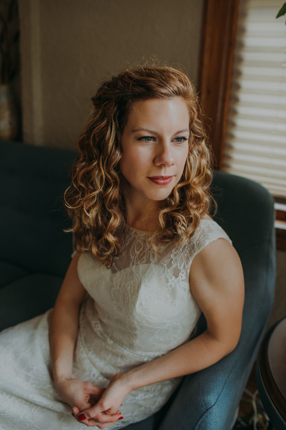 A close up of the bride as she looks out a window at a Milwauke Air B&B