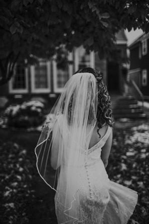 A bride walks towards the front door of an Air BnB in Wisconsin