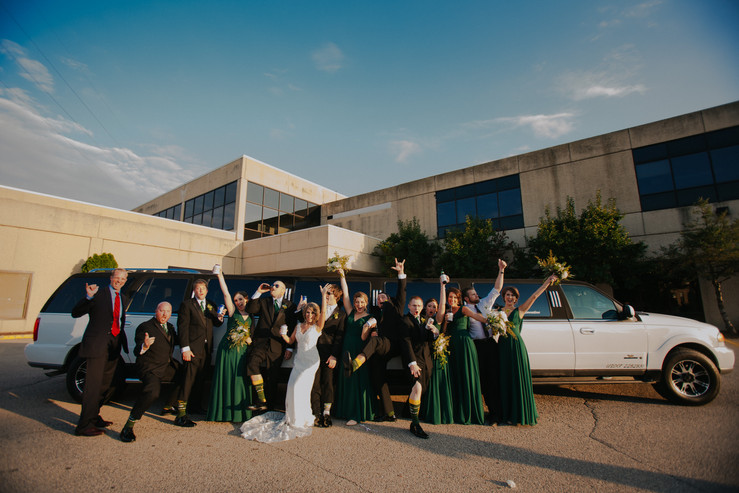 A wedding party poses in front of Beckets wedding venue