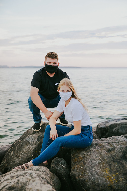 A couple wears masks during a coronavirus engagement session