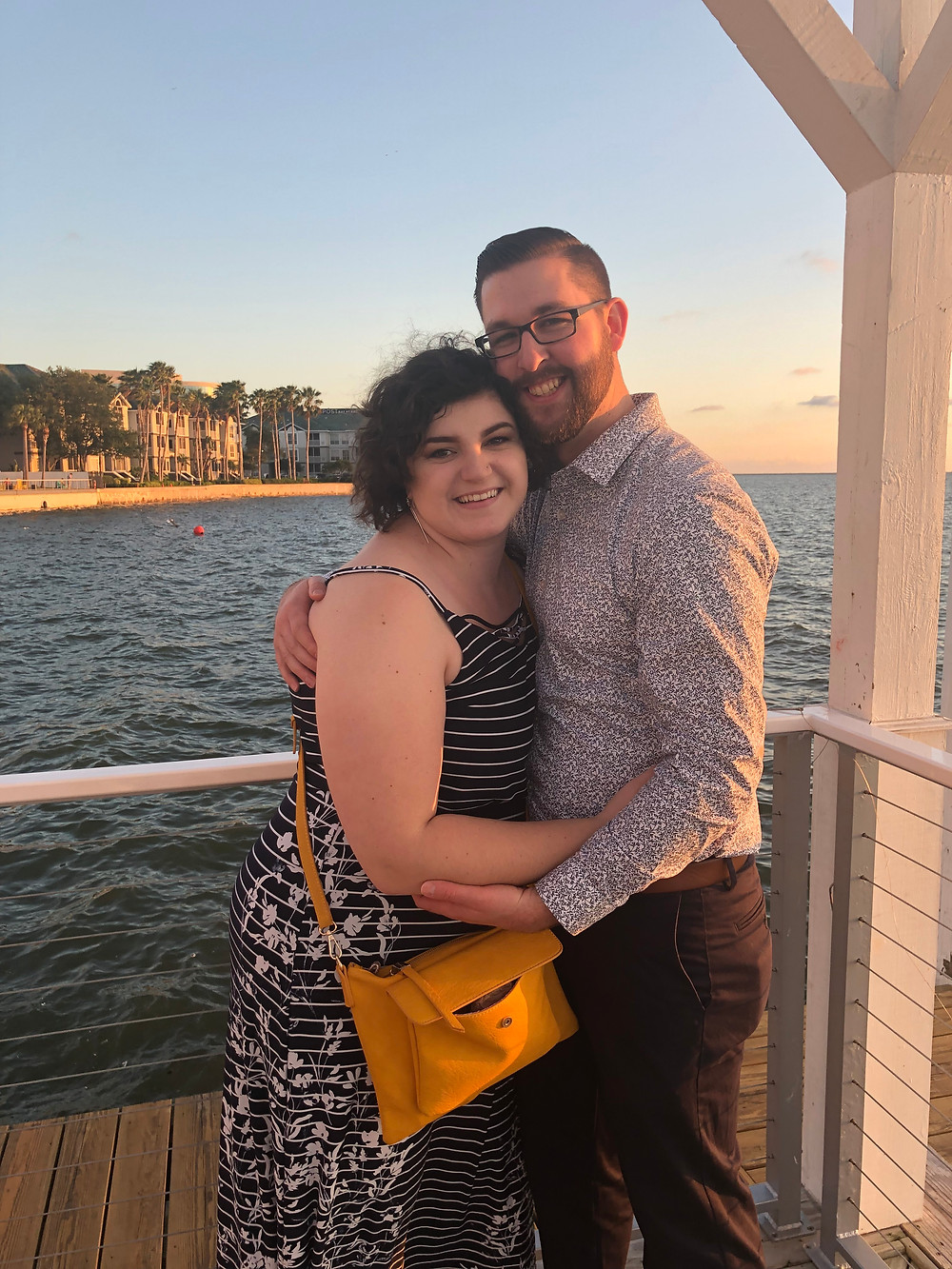 A man and woman hug on a deck in Tampa FL