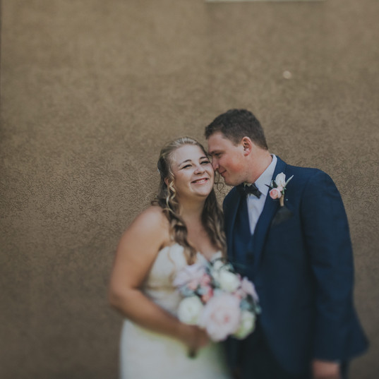 A man nuzzles a woman's cheek at an intimate wedding in Stevens Point Wisconsin