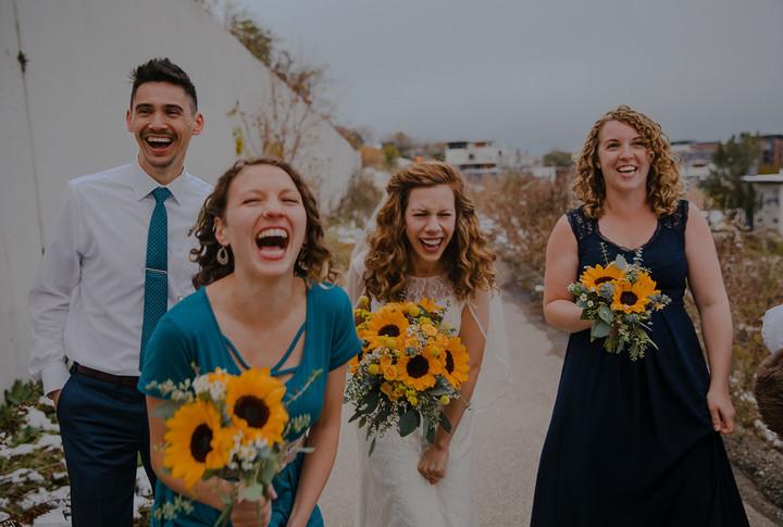 Members of a wedding party laugh at the camera at Kadish Park