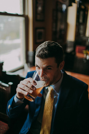 A groom takes a sip of beer at the Red Lion Pub Milwaukee