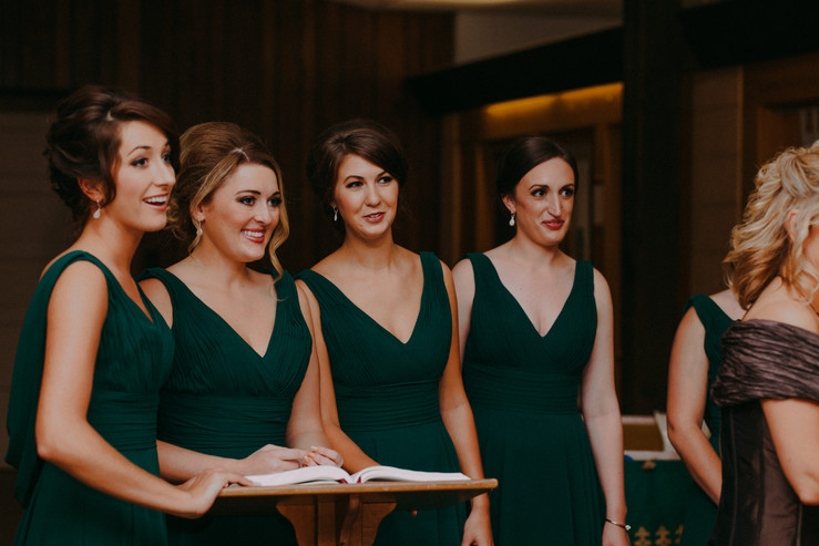 Bridesmaids smile and laugh together