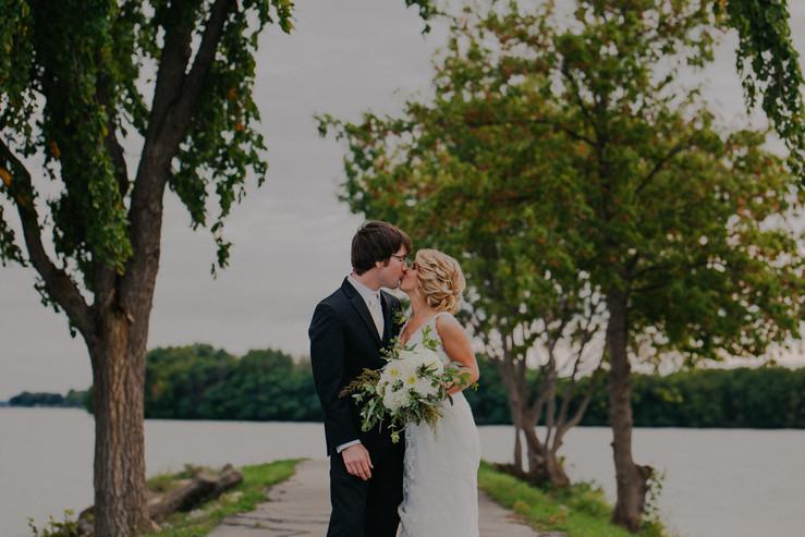A bride and groom kiss during a Oshkosh wedding photos