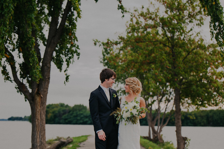 A bride and groom walk during Asylum Point wedding photography