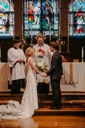 A bride and groom stand at an alter during their Oshkosh wedding