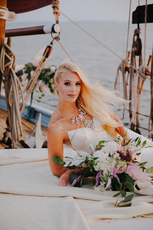 A bride poses during her Door County Wedding
