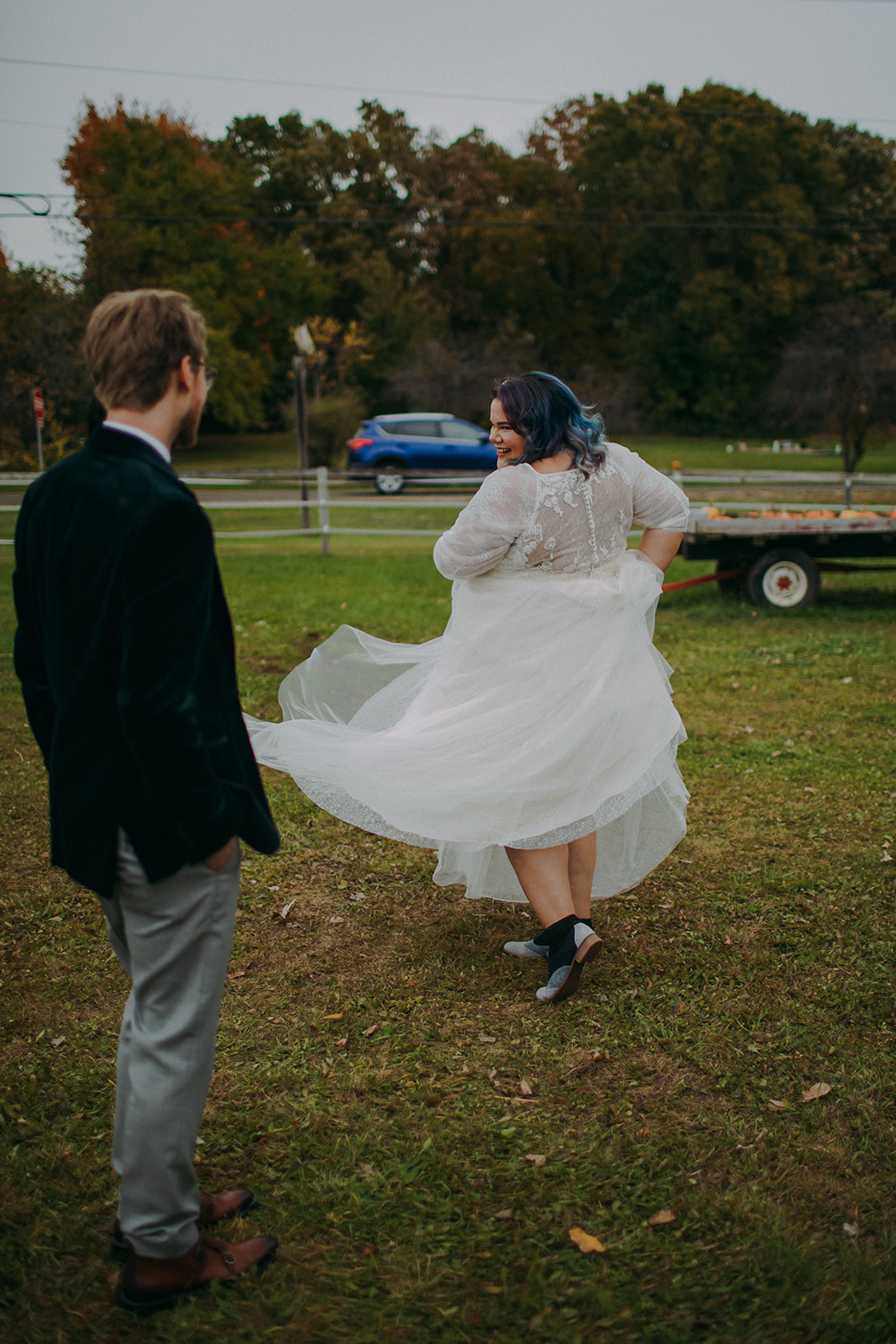 A bride twirls in her dress for her groom during a wisconsin wedding
