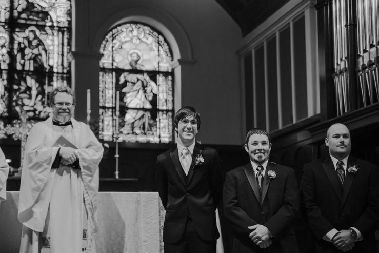 A groom smiles during his Oshkosh wedding ceremony