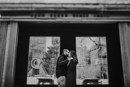 A man and woman stand under a historic bus stop in Milwaukee, WI