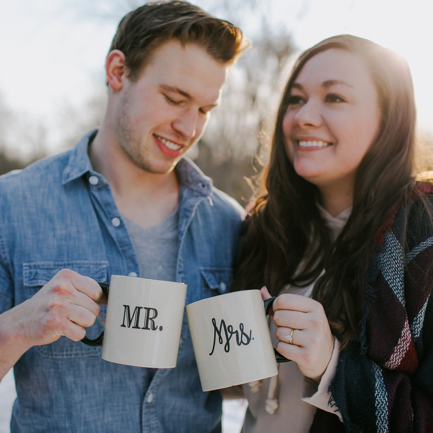 A close up of a man and woman clinking mugs in Stevens Point, Wisconsin