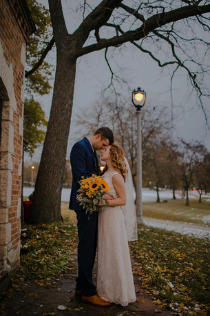 A groom and bride stand forehead to forehead in a Milwaukee Wisconsin wedding